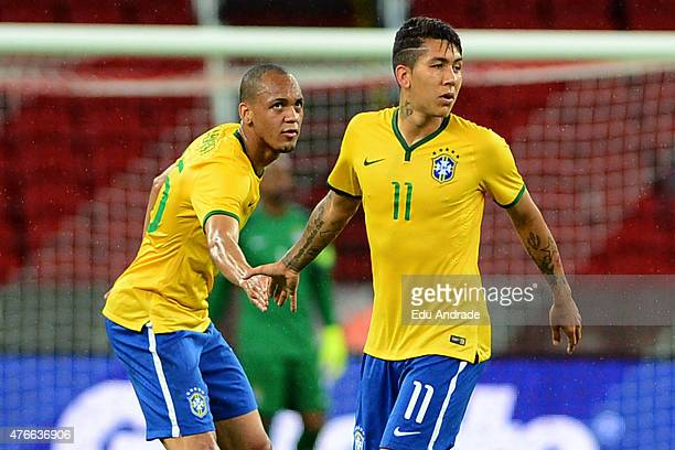 Roberto Firmino of Brazil celebrates after scoring the first goal of his team during the international friendly match between Brazil and Honduras at...