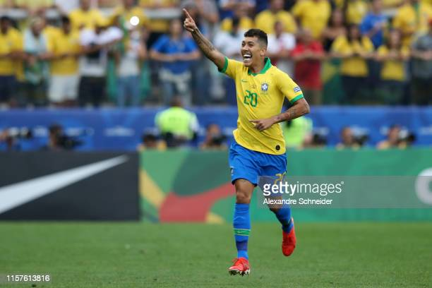 Roberto Firmino of Brazil celebrates after scoring the second goal of his team during the Copa America Brazil 2019 group A match between Peru and...