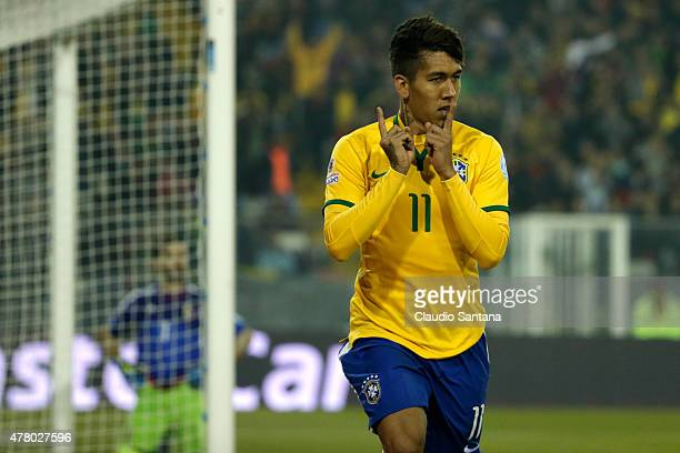 Roberto Firmino of Brazil celebrates after scoring the second goal of his team during the 2015 Copa America Chile Group C match between Brazil and...