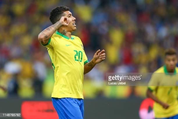 Roberto Firmino of Brazil celebrates their sixth goal during the match Brazil v Honduras, at Beira-Rio Stadium on June 9 in Porto Alegre, Brazil.