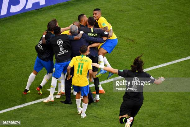 Roberto Firmino of Brazil celebrates with teammates after scoring his team's second goal during the 2018 FIFA World Cup Russia Round of 16 match...