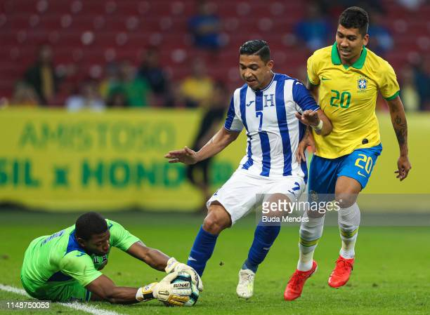 Roberto Firmino of Brazil competes for the ball with Emilio Izaguirre and goalkeeper Luis Lopez of Honduras during the International Friendly Match...