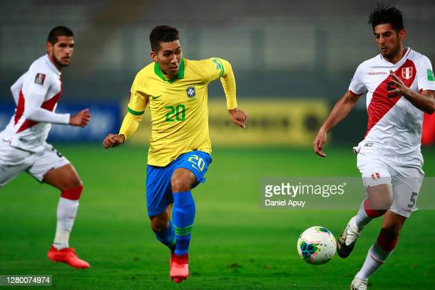 Roberto Firmino of Brazil controls the ball against Carlos Zambrano of Peru during a match between Peru and Brazil as part of South American...