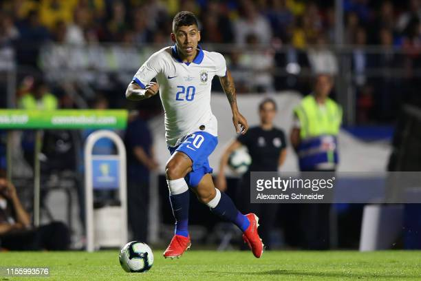 Roberto Firmino of Brazil controls the ball during the Copa America Brazil 2019 Opening Ceremony ahead of group A match between Brazil and Bolivia at...