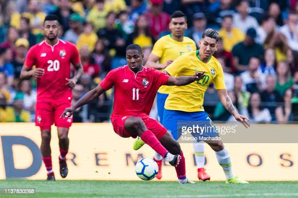 Roberto Firmino of Brazil fights for the ball with Armando Cooper of Panama during the International Friendly Match between Brazil and Panama at...
