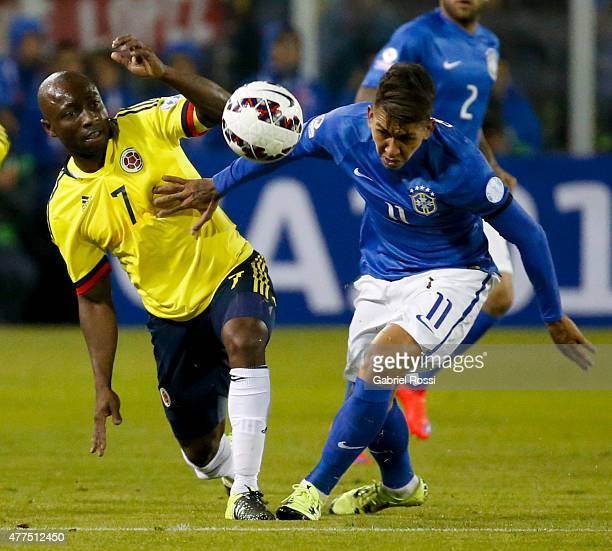 Roberto Firmino of Brazil fights for the ball with Pablo Armero of Colombia during the 2015 Copa America Chile Group C match between Brazil and...