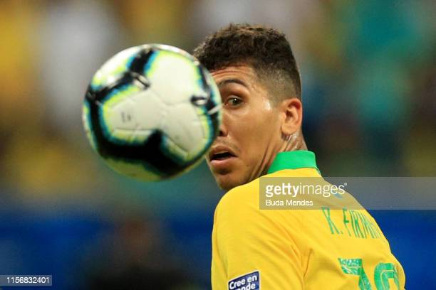 Roberto Firmino of Brazil looks at the ball during the Copa America Brazil 2019 group A match between Brazil and Venezuela at Arena Fonte Nova on...