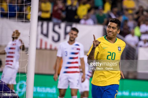 Roberto Firmino of Brazil National Soccer Team holds up one finger to celebrate his goal in the 1st half during the friendly match between Brazil and...