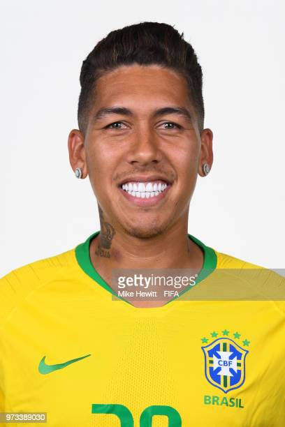 Roberto Firmino of Brazil poses for a portrait during the official FIFA World Cup 2018 portrait session at the Brazil Team Camp on June 12 2018 in...