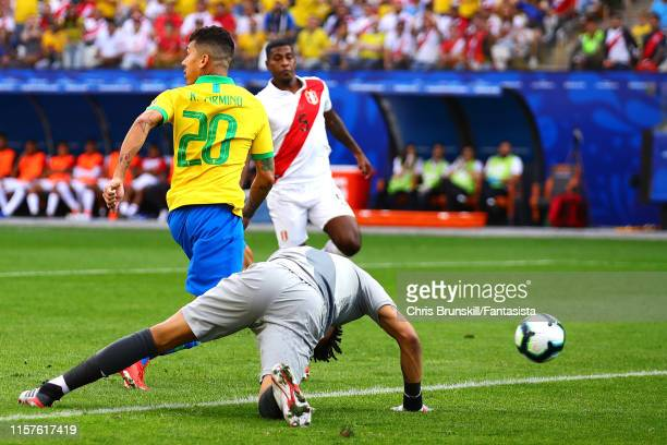 Roberto Firmino of Brazil scores his side's second goal during the Copa America Brazil 2019 group A match between Peru and Brazil at Arena...