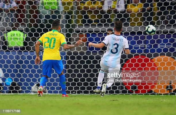 Roberto Firmino of Brazil scores his side's second goal during the Copa America Brazil 2019 Semi Final match between Brazil and Argentina at Mineirao...