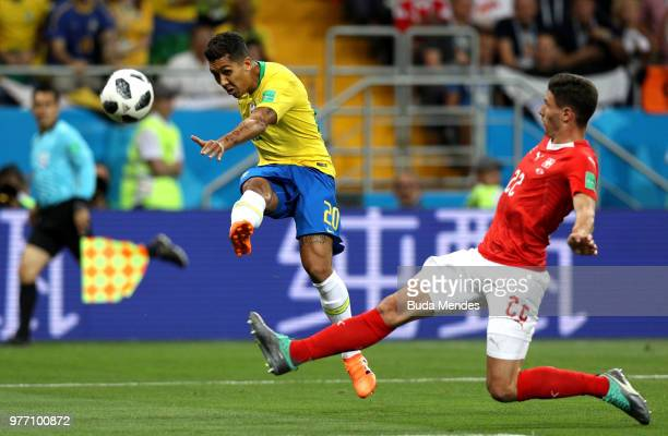 Roberto Firmino of Brazil shoots wide past Fabian Schaer of Switzerland during the 2018 FIFA World Cup Russia group E match between Brazil and...