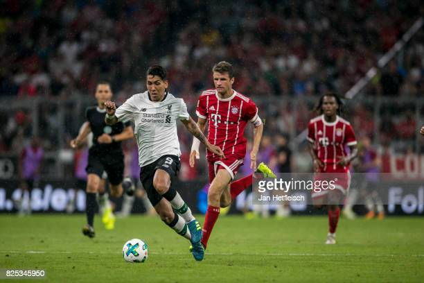 Roberto Firmino of FC Liverpool and Thomas Mueller of FC Bayern Muenchen fight for the ball during the Audi Cup 2017 match between Bayern Muenchen...