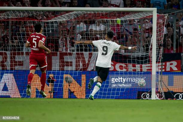 Roberto Firmino of FC Liverpool reacts after his team scores a goal during the Audi Cup 2017 match between Bayern Muenchen and Liverpool FC at...