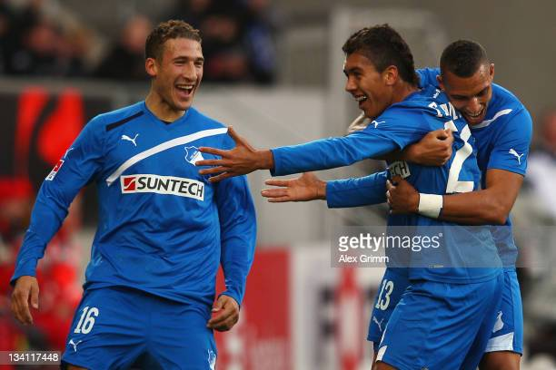Roberto Firmino of Hoffenheim celebrates his team's first goal with team mates Fabian Johnson and Daniel Williams during the Bundesliga match between...