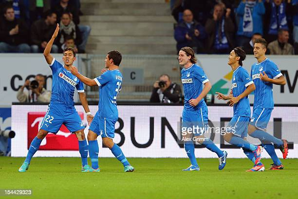 Roberto Firmino of Hoffenheim celebrates his team's first goal with team mates Kevin Volland, Sebastian Rudy, Takashi Usami and Joselu during the...