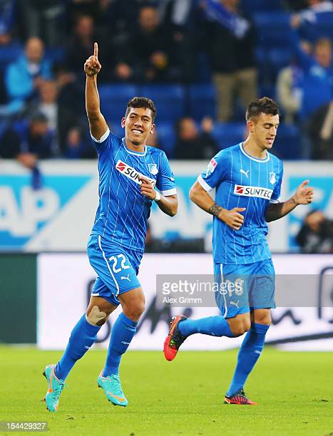 Roberto Firmino of Hoffenheim celebrates his team's first goal with team mate Joselu during the Bundesliga match between 1899 Hoffenheim and SpVgg...