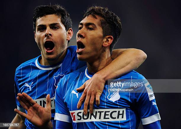 Roberto Firmino of Hoffenheim celebrates his team's first goal with team mate Kevin Volland during the Bundesliga match between TSG 1899 Hoffenheim...