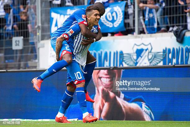 Roberto Firmino of Hoffenheim celebrates with team mate Anthony Modeste after scoring his team's second goal during the Bundesliga match between 1899...