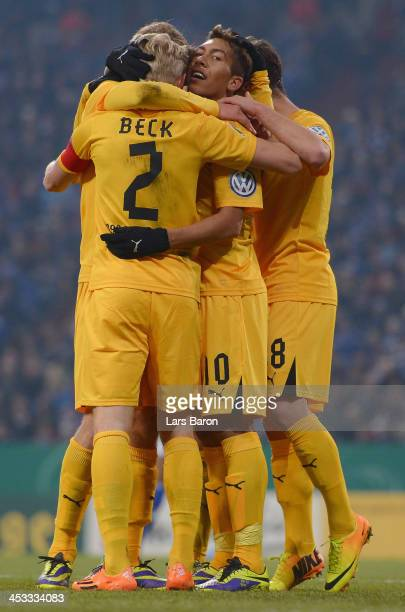 Roberto Firmino of Hoffenheim celebrates with team mates after scoring his teams third goal during the DFB Cup round of 16 match between FC Schalke...