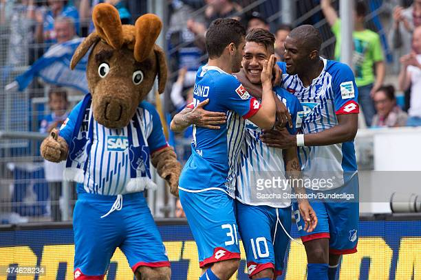 Roberto Firmino of Hoffenheim celebrates with team mates after scoring his team's second goal during the Bundesliga match between 1899 Hoffenheim and...