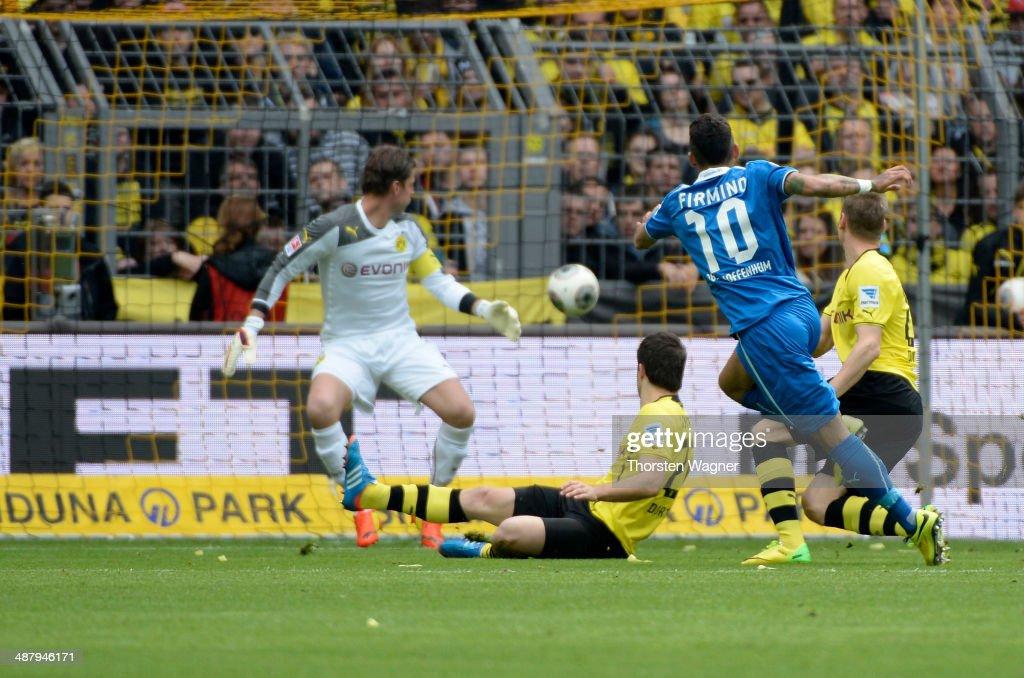 Roberto Firmino of Hoffenheim is scoring his teams opening goal during the Bundesliga match between Borussia Dortmund and TSG 1899 Hoffenheim at Signal Iduna Park on May 3, 2014 in Dortmund, Germany.