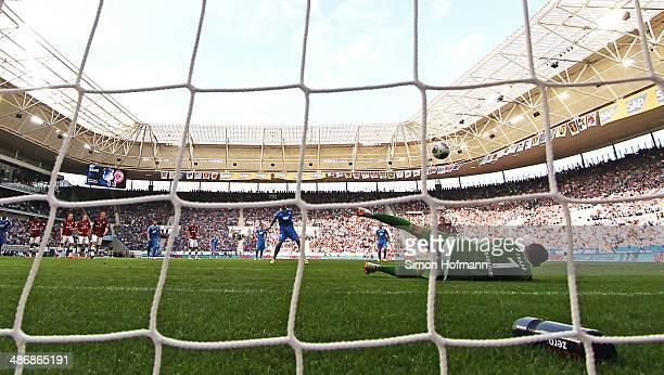 Roberto Firmino of Hoffenheim misses a penalty shot againt goalkeeper Kevin Trapp of Frankfurt during the Bundesliga match between 1899 Hoffenheim...