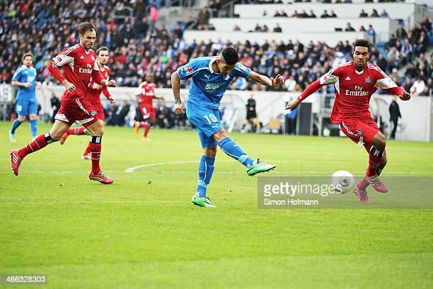 Roberto Firmino of Hoffenheim scores his team's first goal against Jonathan Tah of Hamburg during the Bundesliga match between 1899 Hoffenheim and...