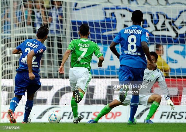 Roberto Firmino of Hoffenheim scores his teams third goal during the Bundesliga match between TSG 1899 Hoffenheim and VFL Wolfsburg at...