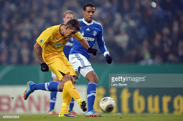 Roberto Firmino of Hoffenheim scores his teams third goal during the DFB Cup round of 16 match between FC Schalke 04 and 1899 Hoffenheim at...