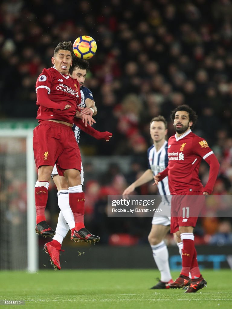 Roberto Firmino of Liverpool and Claudio Yacob of West Bromwich Albion during the Premier League match between Liverpool and West Bromwich Albion at Anfield on December 13, 2017 in Liverpool, England.