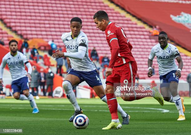 Roberto Firmino of Liverpool and Ezri Konsa of Aston Villa in action during the Premier League match between Liverpool and Aston Villa at Anfield on...