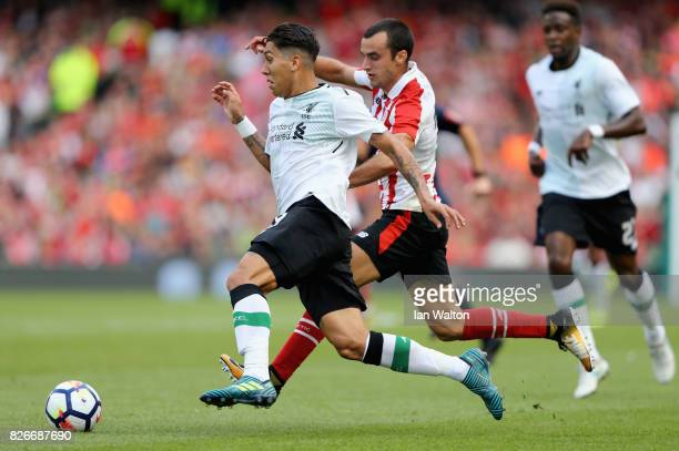 Roberto Firmino of Liverpool and Inigo Lekue of Athletic Club battle for possession during the Pre Season Friendly match between Liverpool and...