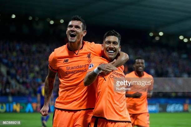 Roberto Firmino of Liverpool and Lovren Dejan celebrates after scoring the fifth goal of Liverpool FC during the UEFA Champions League match between...