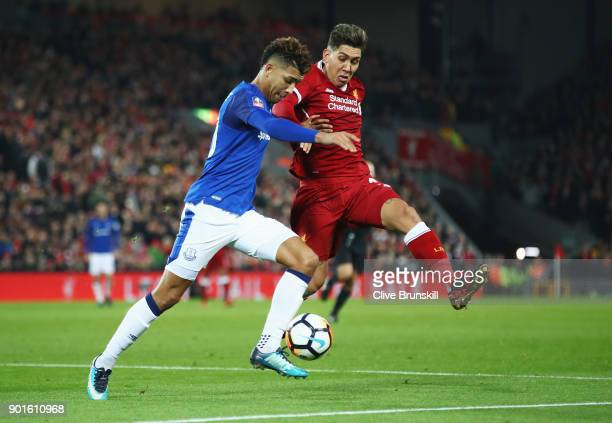 Roberto Firmino of Liverpool and Mason Holgate of Everton battle for the ball during the Emirates FA Cup Third Round match between Liverpool and...