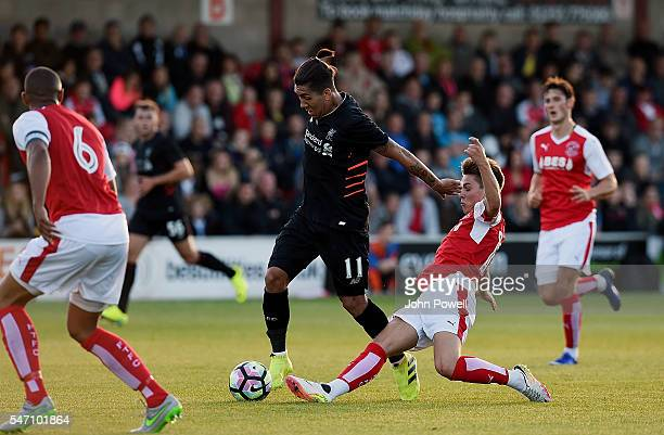 Roberto Firmino of Liverpool and Nick Haughton of Fleetwood Town during the PreSeason Friendly match bewteen Fleetwood Town and Liverpool at Highbury...