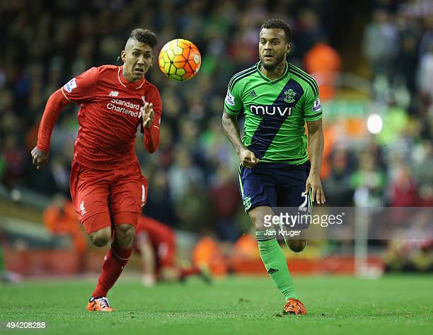 Roberto Firmino of Liverpool and Ryan Bertrand of Southampton compete for the ball during the Barclays Premier League match between Liverpool and...