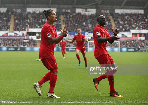 Roberto Firmino of Liverpool and Sadio Mane of Liverpool celebrates their sides first goal during the Premier League match between Swansea City and...