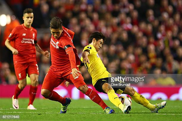 Roberto Firmino of Liverpool and Shinji Kagawa of Borussia Dortmund battle for the ball during the UEFA Europa League quarter final second leg match...