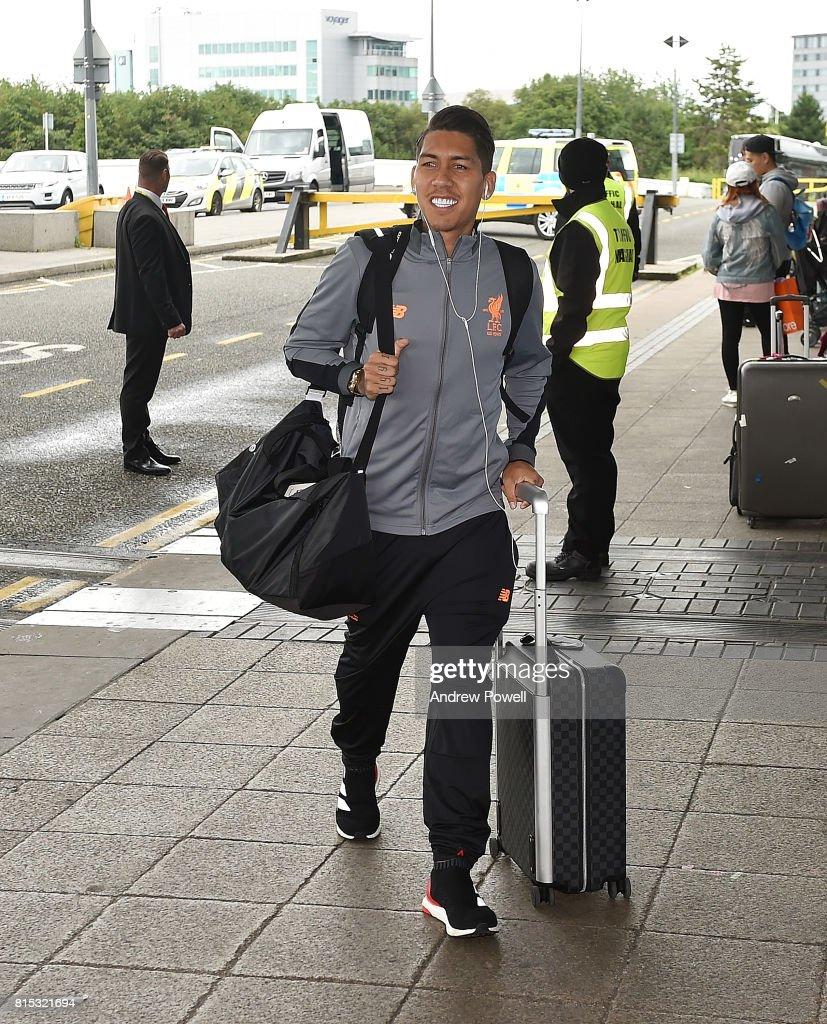 Roberto Firmino of Liverpool arrives at Manchester Airport on July 16, 2017 in Liverpool, England.