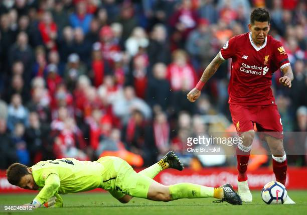 Roberto Firmino of Liverpool attempts to take the ball past Asmir Begovic of AFC Bournemouth during the Premier League match between Liverpool and...