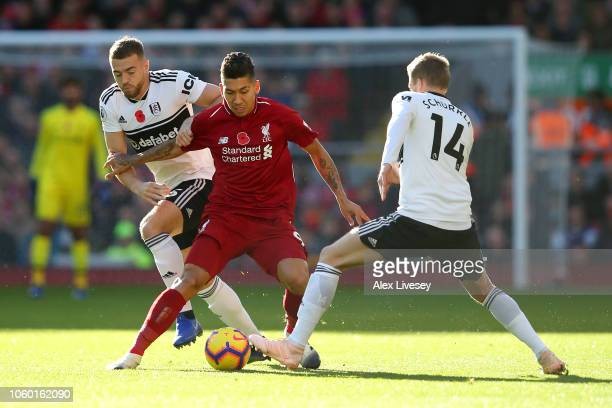 Roberto Firmino of Liverpool battles for possession with Calum Chambers and Andre Schurrle of Fulham during the Premier League match between...
