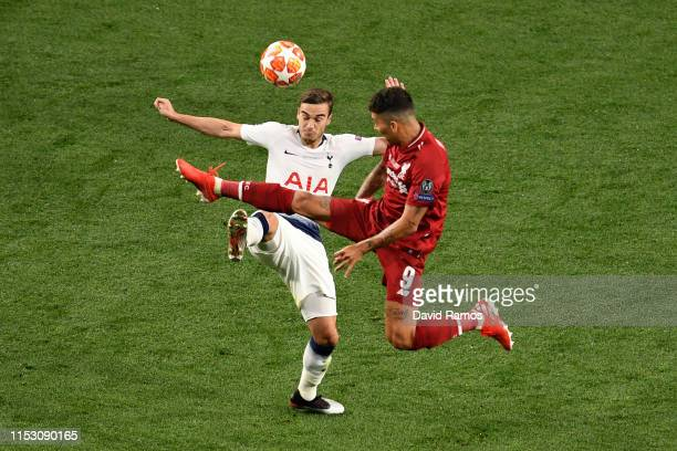 Roberto Firmino of Liverpool battles for possession with Harry Winks of Tottenham Hotspur during the UEFA Champions League Final between Tottenham...