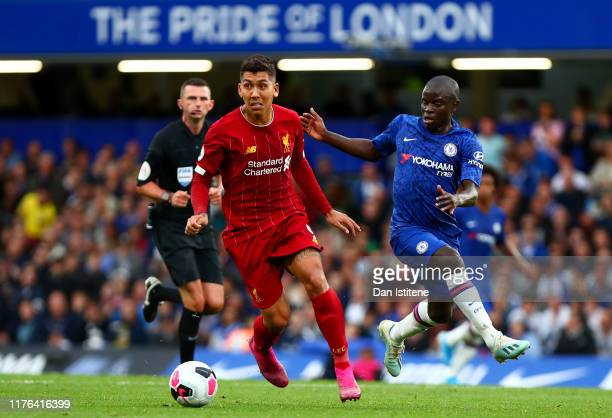 Roberto Firmino of Liverpool battles for the ball with Ngolo Kante of Chelsea during the Premier League match between Chelsea FC and Liverpool FC at...