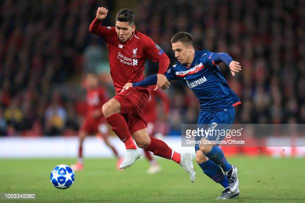 Roberto Firmino of Liverpool battles with Branko Jovicic of Crvena during the Group C match of the UEFA Champions League between Liverpool and FK...