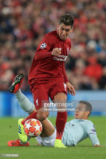 Roberto Firmino of Liverpool battles with Thiago Alcantara of Bayern during the UEFA Champions League Round of 16 First Leg match between Liverpool...