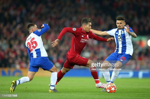 Roberto Firmino of Liverpool beats Otavio and Francisco Soares of Porto during the UEFA Champions League Quarter Final first leg match between...