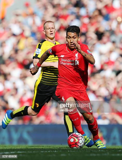 Roberto Firmino of Liverpool breaks through to score his side's second goal during the Barclays Premier League match between Liverpool and Watford at...