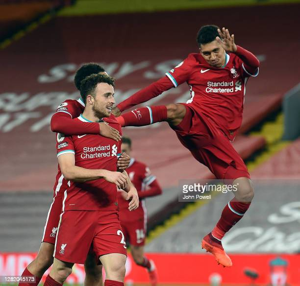 Roberto Firmino of Liverpool celabrates Diago Jota of Liverpool winning goal during the Premier League match between Liverpool and Sheffield United...