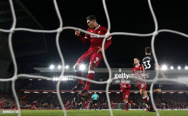 Roberto Firmino of Liverpool celebrates a goal during the Premier League match between Liverpool and Swansea City at Anfield on December 26 2017 in...